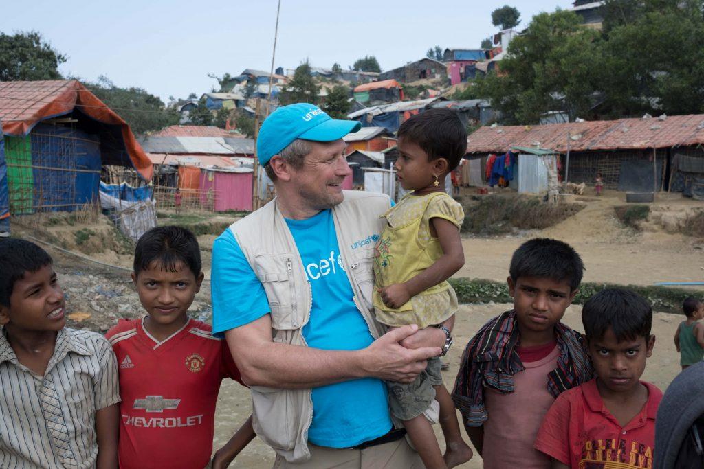 marth worth, head of Wash, holding Bangladeshi children