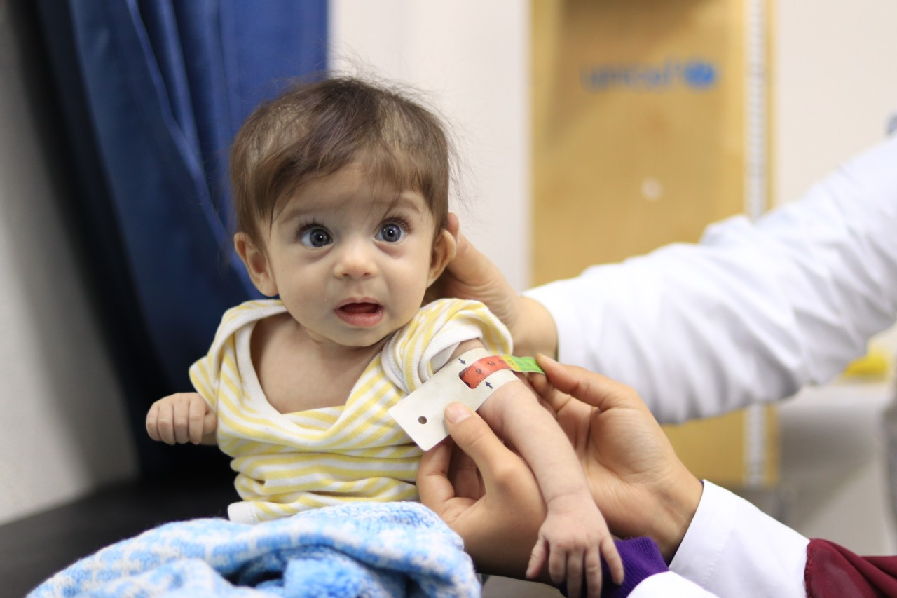Baby Jana is assessed for malnutrition using a MUAC band at a UNICEF supported health center in Aleppo Syria