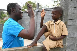 a child and a man are clapping hands