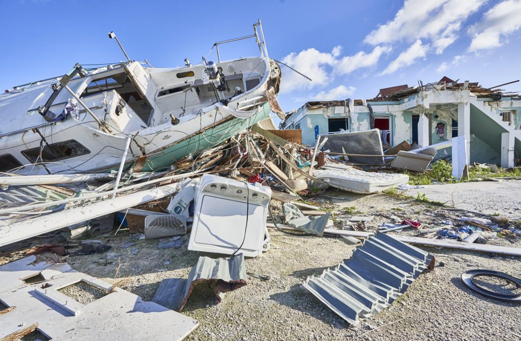 a house and a boat completely destroyed