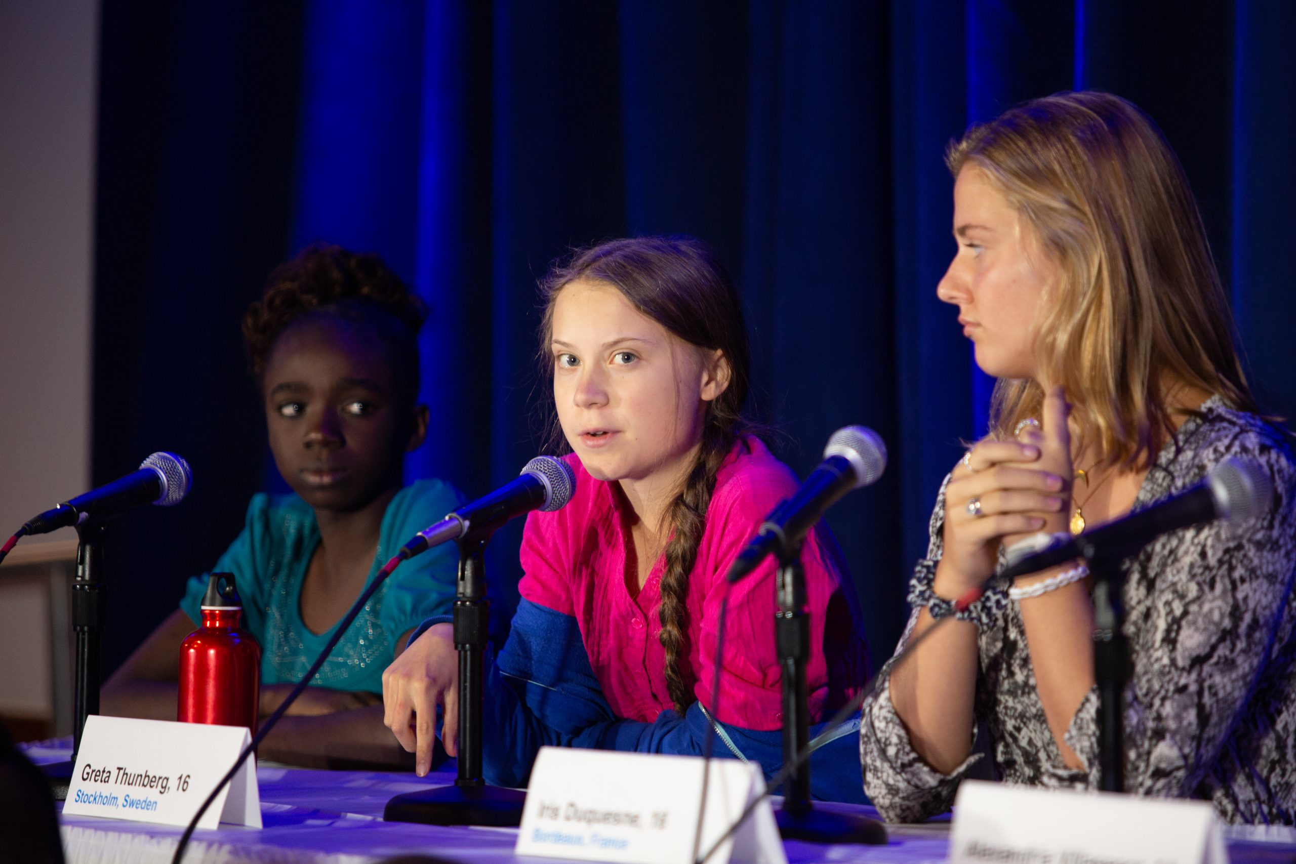 greta thunberg speaks at a conference