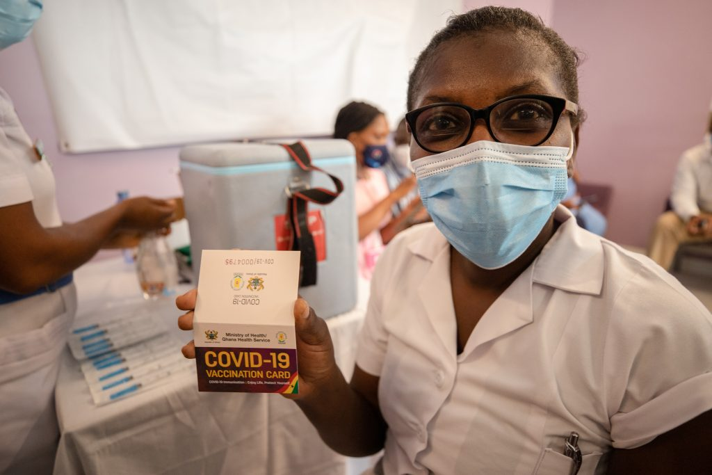 health care worker gets covid vaccine
