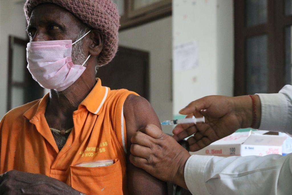 nepali man receives covid vaccine