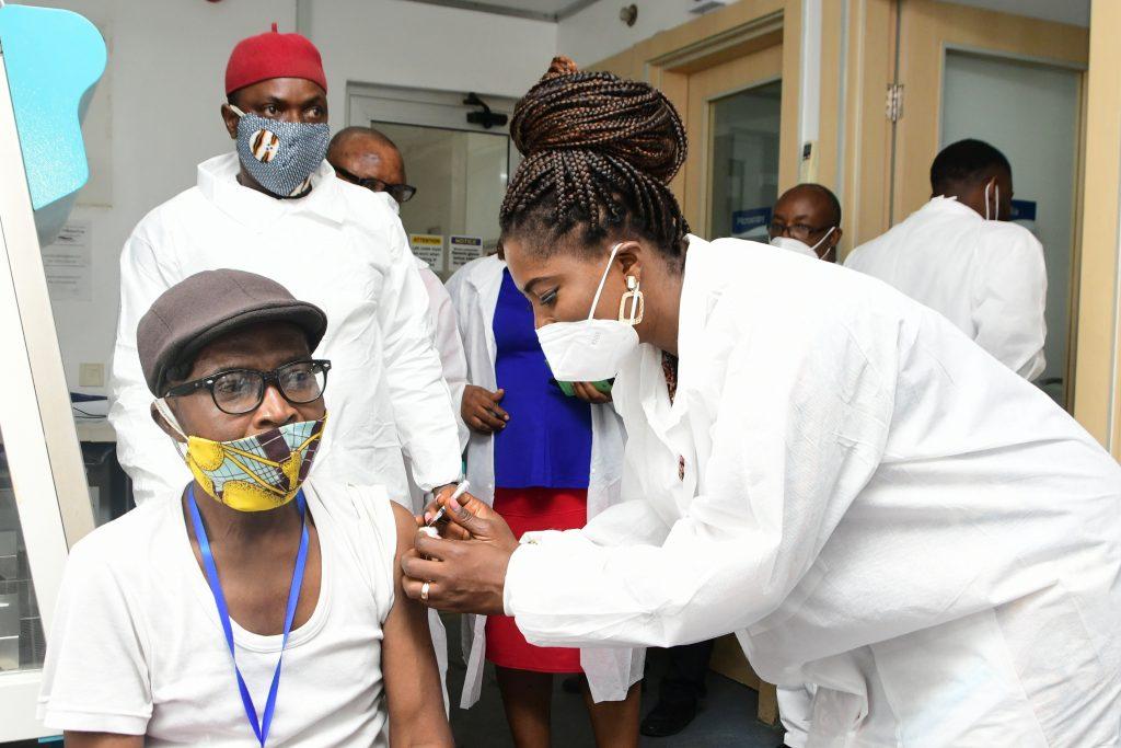 man receives covid-19 vaccine
