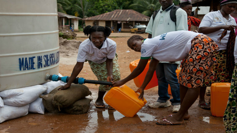 Ebola survivors deliver water as Sierra Leone pushes to zero