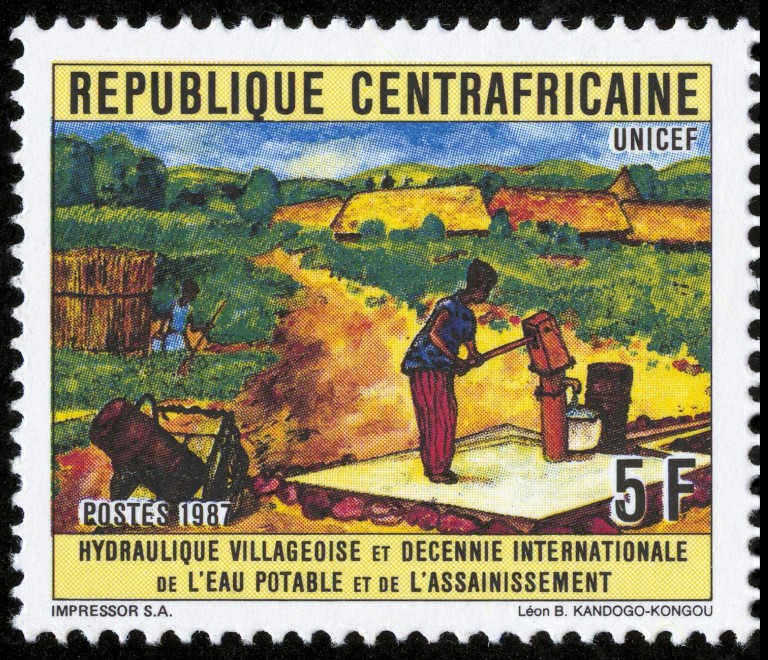 A 1987 postage stamp from the Central African Republic bears the text 'UNICEF' and shows a woman filling a container with water at a Mark II handpump in a village clearing. The stamp also bears the text 'Village Handpump and International Decade of Safe Water and Sanitation' in French. The India Mark II deep-well handpump was developed in 1974 in collaboration with the Government of India, private industry and UNICEF. The durable low-cost device, which became a part of India's rural drinking water programme, was soon exported to many other developing countries. UNICEF's support for the Mark II helped position the organization at the forefront of the international drive to bring safe water and basic sanitation to poor communities.