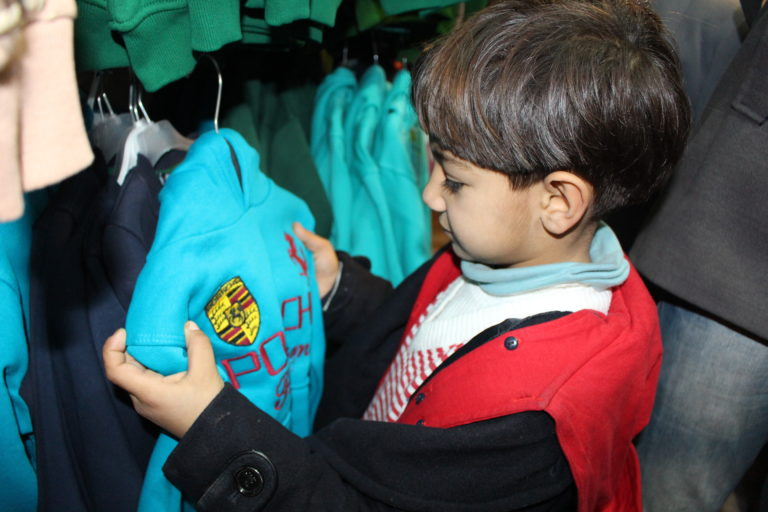 On 29 December 2016, 5 year-old Thiyaa came with his parents to a clothing store in Qamishli to buy new winter clothes for him and his two siblings using e-vouchers they received from UNICEF. Families receive vouchers similar to ATM cards, and use them at a network of 31 stores in Syria to buy a full set of winter clothes for their children. A kit includes a jacket, a woolen sweater, a thermal outfit, warm winter trousers, woolen hat, scarf, gloves, socks and a pair of winter boots. Date: 29-12-2016 Location: Qamishli, Hasakah Governorate UNICEF started the distribution of e-vouchers to the most vulnerable families in Qamishli, in northeastern Syria, to buy winter clothes for their children. Families receive vouchers similar to ATM cards, and use them at a network of 31 stores in Syria to buy a full set of children's clothes for winter. A set includes a jacket, a woolen sweater, a thermal outfit, warm winter trousers, woolen hat, scarf, gloves, socks and a pair of winter boots. As prices, inflation and unemployment increase, internally displaced families in Syria cannot afford basic items like warm clothing for their children. Most of them live in shelters with inadequate heating and protection from the cold. Not only do e-vouchers help parents to provide warm clothing for their children, they also empower them to choose the color, size and items they want to buy for their children. This winter, UNICEF aims to provide 57,000 children in Tartus, Lattakia, Homs, Damascus and Qamishli Governorates with winter clothes through the e-voucher programme.