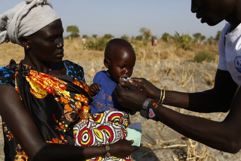 Angelina Nyanin, 25, holds her niece, Nyalel Gatcauk, 2, who suffers from malnutrition, as a UNICEF nutrition worker feeds the baby Plumpy'Nut, a peanut-based paste for treatment of severe acute malnutrition during a Rapid Response Mechanism (RRM) mission in Thonyor, Leer county, South Sudan, February 26, 2017. Angelina has five children of her own. They come from a village called Waluk, a two hours walk from the WFP registration area. Armed men killed her husband last year during a raid. Nyalel is the daughter of her brother. Angelina explained how in August last year her village was attacked by what she said were government soldiers. In the incident the soldiers took the mother of Nyalel away. She has never returned. She now provides for Nyalel as a mother. SheÕs alone, taking care of six children. The father of Nyalel is in Khartoum. ÒWhen they attacked the village I managed to run away with my children into the bush. When I returned at night Nyalel was in the house, but her mother was gone. The armed men that came for us that day and killed people randomly. They burned down many houses. Food and insecurity are our biggest worries. Because of the fighting that is going on around us it is difficult to find food. We are forced to collect and eat water lilies from the swamp. But the children donÕt react well to them. They loose weight quickly. I wish I could give my children a normal life. I wish I could send them to school, buy new clothes for them. I wish I could see them play outside the house during the day. But this is not possible now. The war has ruined everything in our livesÓ, Angelina explains. In areas affected by insecurity and cut off from humanitarian assistance, including Leer, Koch and Manyedit counties, UNICEF, in collaboration with World Food Programme and partners, are working to reach the most vulnerable children with acute malnutrition through Rapid Response Missions and to re-establish static services in areas with relative calm. Further