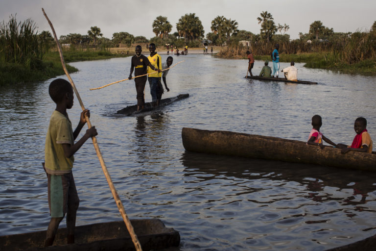 People cross a swamp area on canoes near Thonyor, Leer county to reach the registration site for the Rapid Response Mechanism, in South Sudan, February 23, 2017. In areas affected by insecurity and cut off from humanitarian assistance, including Leer, Koch and Manyedit counties, UNICEF, in collaboration with World Food Programme and partners, are working to reach the most vulnerable children with acute malnutrition through Rapid Response Missions and to re-establish static services in areas with relative calm. Further missions are planned in the coming days and weeks to address the nutrition crisis. In March 2017, war and a collapsing economy have left some 100,000 people facing starvation in parts of South Sudan where famine was declared 20 February, three UN agencies warned. A further 1 million people are classified as being on the brink of famine. The Food and Agriculture Organization of the United Nations (FAO), the United Nations Children's Fund (UNICEF) and the World Food Programme (WFP) also warned that urgent action is needed to prevent more people from dying of hunger. If sustained and adequate assistance is delivered urgently, the hunger situation can be improved in the coming months and further suffering mitigated. The total number of food insecure people is expected to rise to 5.5 million at the height of the lean season in July if nothing is done to curb the severity and spread of the food crisis. According to the Integrated Food Security Phase Classification (IPC) update released 20 February by the government, the three agencies and other humanitarian partners, 4.9 million people – more than 40 percent of South Sudan's population – are in need of urgent food, agriculture and nutrition assistance. Unimpeded humanitarian access to everyone facing famine, or at risk of famine, is urgently needed to reverse the escalating catastrophe, the UN agencies urged. Further spread of famine can only be prevented if humanitarian assistance is scaled u