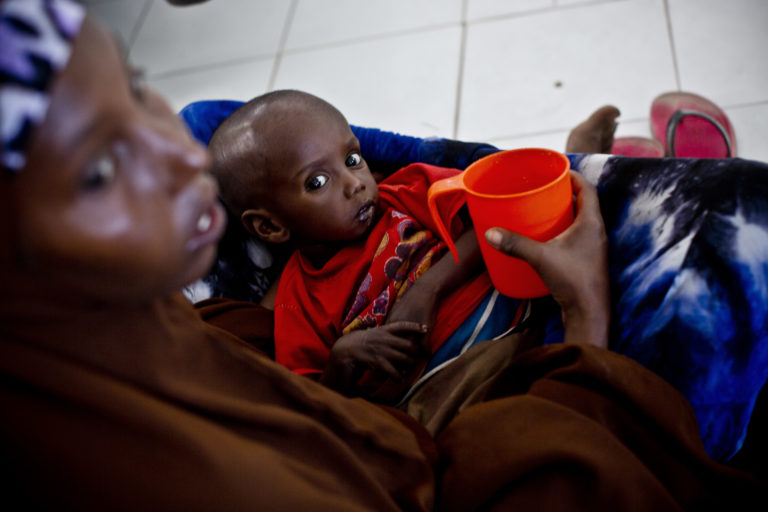A severely malnourished child is held by its mother at the referral hospital in Hargeisa, Somalia, Saturday 11 March 2017. As the humanitarian situation in Somalia continues to deteriorate in early 2017, an estimated 6.2 million people (about half of the population) are either severely food insecure or in need of livelihood support. Severe drought is now affecting all regions, following the failure of two or more consecutive rains, and with the last 'Deyr' season (October-December) performing poorly and large areas receiving less than 40 percent normal rainfall. The ongoing drought and other shocks have left communities with little or no remaining resources. Entire villages have lost their crops or seen their livestock die. The prices for water and locally produced food have risen dramatically, and thousands of people are on the move in search of food and water. The drought is also exacerbating the existing nutrition crisis in the country, where more than 363,000 children under the age of 5 are acutely malnourished, including 71,000 suffering from severe acute malnutrition (SAM) and in urgent need of life-saving treatment. UNICEF estimates that by April 2017, 750,000 people will need health assistance and 4.5 million will need water, sanitation and hygiene (WASH) support. Also, should the next rains prove inadequate and humanitarian assistance not reach drought-affected populations, there is a risk of famine in the second half of 2017. The drought has also led to an increase in waterborne diseases, with more than 4,000 cases of acute watery diarrhoea/cholera this year. UNICEF and the World Food Programme are working together to scale up their responses in accessible areas, where millions of lives are at risk. Joint efforts include providing food and water vouchers for hundreds of thousands of people in drought-affected areas, and supporting life-saving services in nutrition, food security, health, education, water and sanitation. As needs mounts, UNICEF and W