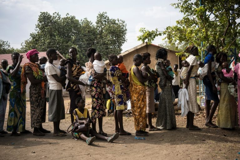Mothers queue with their sick children in order for them to be weighed and screened for malnutrition at Al Sabbah Children's Hospital in Juba, South Sudan.