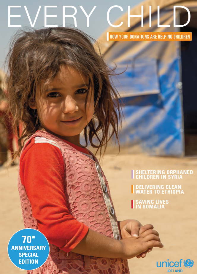 Little girl in a refugee camp facing the camera for UNICEF Newsletter