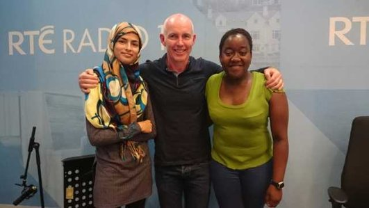 Two teenagers with someone from RTE Radio in the RTE studio