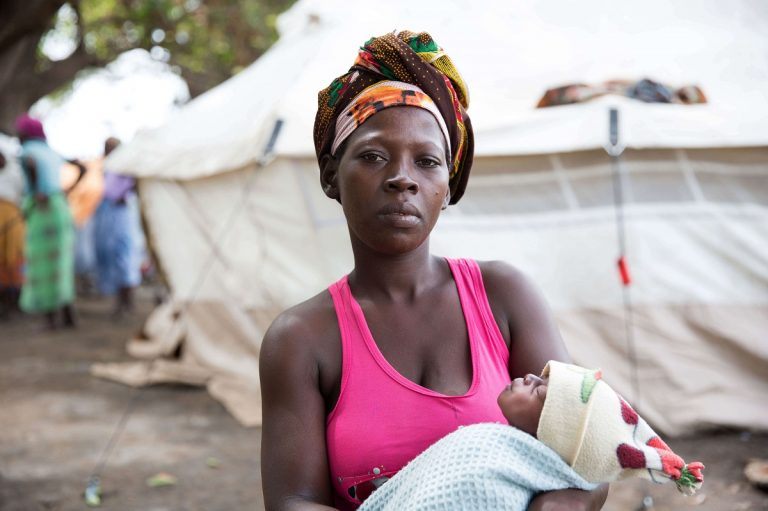 Mozambique mother holding her newborn baby